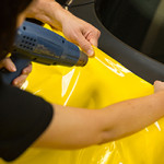 Car wrappers using heat gun to prepare vinyl foil